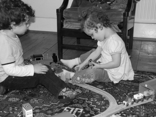 Toddlers playing with trains